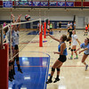 Winnacunnet Junior Sydney Powers spikes the ball over the net with teammates defending during Monday's Girls Volleyball practice on 8-29-2016 @ WHS.  Matt Parker Photos