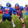 8th Grader's #45 Camden MacDonald gets past #15 Cooper Goucher during a blocking drill at Monday's 6th Annual Winnacunnet Warriors Veer Football Camp on 8-1-2016 @ WHS.  Matt Parker Photos
