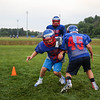 7th Grader #35 Matthew Alkire and 8th Grader #45 Camden MacDonald work on a blocking drill at Monday's 6th Annual Winnacunnet Warriors Veer Football Camp on 8-1-2016 @ WHS.  Matt Parker Photos