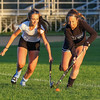 Winnacunnet High School Senior Alyssa Crochetiere (R)  and Freshman sister Sam being competitive on the field while having a successful season playing together on the Warriors Varsity Field Hockey team.  Photos taken after Tuesday's practice on 10-3-2017 @ WHS.  Matt Parker Photos