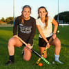 Winnacunnet High School sisters, Senior Alyssa(L) and Freshman Sam Crochetiere pose for a photo with their Field Hockey sticks after Tuesday's practice on 10-3-2017 @ WHS.  Matt Parker Photos