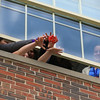 A group effort made to release the egg capsule from the 2nd floor library window with STEM teacher Kellie Burtch (R) looking on during Tesday's STEM class on 2-21-2017 @ Hampton Academy Junior High.  Matt Parker Photos