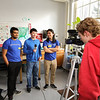 HAJH Shark Reporter 8th grader Nathan Dang (center) interviews UNH Chemical Engineering major Tito Das (L) and Mathematics and Philosophy major Eden Suoth (R) during Tuesday's STEM class egg drop experiment with Videographer 8th grader Jack Hansen recording the program on Tuesday 2-21-2017 @ Hampton Academy Junior High.  Matt Parker Photos