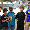 STEM student's (L to R) Cameron Dunham, Nathan Domingos, Tyler Valdez, John Savage and UNH Mathematics and Philosophy major Eden Suoth inspect their egg after the egg drop experiment on Tuesday 2-21-2017 @ Hampton Academy Junior High.  Matt Parker Photos