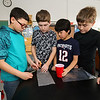 STEM student's (L to R) Tyler Valdez, Cameron Dunham, Nathan Domingos and John Savage cut protective wrap to protect their raw egg from a 2 story drop onto the parking lot on Tuesday 2-21-2017 @ Hampton Academy Junior High.  Matt Parker Photos