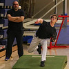 Winnacunnet assistant Coach Tom Lamy watches as SO Patrick Quinn throws a pitch at Wednesday's preseason practice on 3-22-2017 @ WHS.  Matt Parker Photos