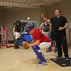 Winnacunnet assistant Coach Tom Lamy throws a ball for JR Corey Markland during a catchers drill at Wednesday's preseason practice on 3-22-2017 @ WHS.  Matt Parker Photos