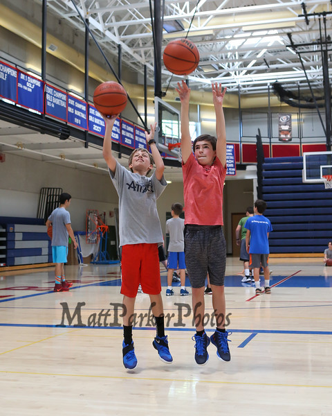 Cam Goodman and Tyler Prunier take shots at the Warrior 6-8th grade Hoop Camp on Wednesday with Coach Jay McKenna and Warrior Basketball players on 6-28-2017 @ WHS.  Matt Parker Photos