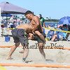 In the 18+ Open Division Carlos Duran (R) of Laurence, MA gets a hold on Nate Stemple of Marlboro, MA on Sunday at the Hampton Beach Wrestling Tournament on the sand at Hampton Beach sponsored by the Winacunnet Wrestling team on 7-30-2017 @ Hampton Beach, NH.  Matt Parker Photos