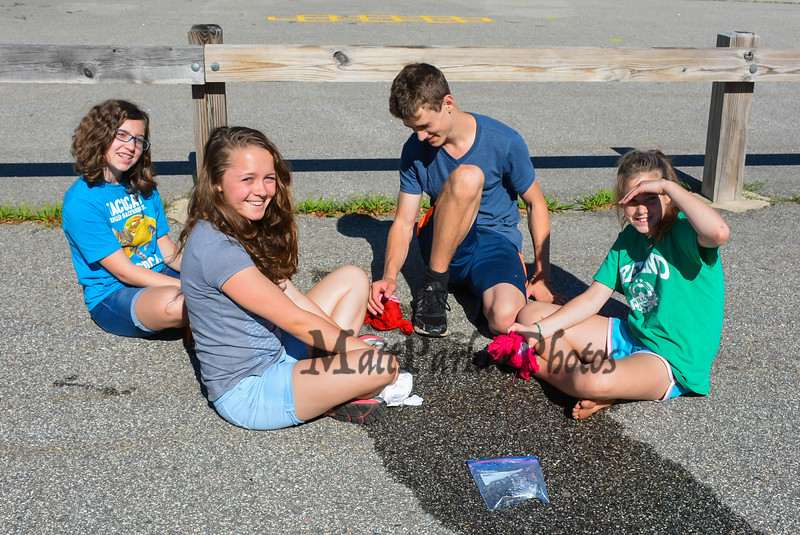 (L to R) Madison Abasciano, Bethany Kimball, Ben Abasciano and Hanna Abasciano work to get their frozen tee shirts loosened up at the Lane Library Summer Reading Kick off EVO Rock Wall and Frozen Tee Shirt events on Wednesday 7-5-2017 @ Centre School, Hampton, NH.  Jenn Beigel Photos