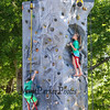 5th grader Elijah Howard and 6th grader Hannah Abasciano work to get to the top of the rock wall at the Lane Library Summer Reading Kick off EVO Rock Wall and Frozen Tee Shirt events on Wednesday 7-5-2017 @ Centre School, Hampton, NH.  Matt Parker Photos