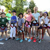 A group of kids with their climbing harness on pose for a photo at the Lane Library Summer Reading Kick off EVO Rock Wall and Frozen Tee Shirt events on Wednesday 7-5-2017 @ Centre School, Hampton, NH.  Matt Parker Photos