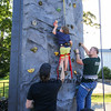 4 year old Brody Elliott of Hampton gets a little help on the rock wall from his father Ryan (L) and EVO staff Tayler Larmie at the Lane Library Summer Reading Kick off EVO Rock Wall and Frozen Tee Shirt events on Wednesday 7-5-2017 @ Centre School, Hampton, NH.  Matt Parker Photos