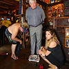 John Nyhan, President of Experience Hampton weighs-in at 218 pounds as recorded by weigh-in official Ashley Mersfelder of Barrington, NH with Desi Lanio verifying for the August weight loss challenge to benefit the Hampton Christmas Parade on Tuesday August 1st, 2017 at the 401 Tavern, Hampton, NH.  Matt Parker Photos