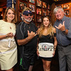 Paula and Desi Lanio of the 401 Tavern (L) and John Nyhan, President of Experience Hampton (R) pose for a photo with Ashley Mersfelder of Barrington, NH the official who supervised the weigh-ins for the weight loss challenge to benefit the Hampton Christmas Parade on Tuesday August 1st, 2017 at the 401 Tavern, Hampton, NH.  Matt Parker Photos