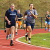 Winnacunnet's Caroline Meuse (L) and Alexis Seta  round the last turn as they head to the finish line in a 400m run at Monday's preseason workout on 8-14-2017 @ WHS.  Matt Parker Photos