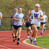 Girls Soccer Captain Ali McNamara leads her teammates around the track during 400m runs at Monday's Preseason workout on 8-14-2017 @ WHS.  Matt Parker Photos