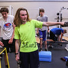 Winnacunnet Senior Jared McCann performs arm lifts with his team in the weight room at Monday's preseason Boy's Cross Country workout at WHS on 8-21-2017.  Matt Parker Photos