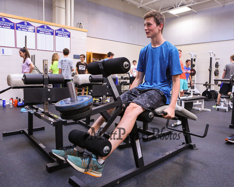 Winnacunnet Sophmore Nolan Duffy works on leg exercises in the weight room at Monday's preseason Boy's Cross Country workout at WHS on 8-21-2017.  Matt Parker Photos