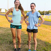 Winnacunnet's Girls 2017 Cross Country Senior Captains McKenzy Wall and Jenny Long pose for a photo at Monday's preseason Girls Cross Country workout at WHS on 8-21-2017.  Matt Parker Photos