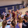 Head Coach Lori Garand with her players during a team cheer after Monday's preseason practice on 8-21-2017 @ WHS.  Matt Parker Photos