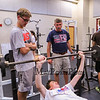 """Winnacunnet's Boys Cross Country Coach Richard Osborne, """"Ozzie"""" gives instructions to Sr Addison Andronaco on bar with Jr Austin Denis spotting at Monday's preseason Boy's Cross Country workout at WHS on 8-21-2017.  Matt Parker Photos"""