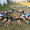 """The Winnacunnet's Girls Cross Country team works on their abs by performing """"planks"""" at Monday's preseason Girls Cross Country workout at WHS on 8-21-2017.  Matt Parker Photos"""