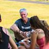 Winnacunnet's Girls Cross Country Coach Jason Saltmarsh talks with his team after Monday's preseason Girls Cross Country workout at WHS on 8-21-2017.  Matt Parker Photos