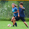Freshmen Parker Banks fends off Brenna Bushe at the Winnacunnet Boys and Girls scrimmage at the WHS Summer Soccer Clinic and workout on Tuesday 8-8-2017 @ WHS.  Matt Parker Photos