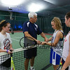 Tennis pro and instructor Kyle Littlefield gives instructions to (L to R) 8th grader Kassie Bashaw of Newbury MA, 7th grader Lauren Furgao of Auburn NH and 8th grader Sydney Budday of Madbury NH at the Sports Barn Basketball and Tennis demonstrations and Grand Opening on Saturday 9-16-2017, Drakeside Road, Hampton, NH.  Matt Parker Photos