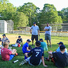 Exeter Baseball All-Star U12 70' Coaches Matt Perodeau (L) and Joe Brackett (R) talk with their players during a water break on a hot Monday evening during practice at Currier Field on 6-12-2017, Exeter, NH.  Matt Parker Photos