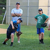 Exeter Baseball All-Star U12 70' pitcher Cole Perodeau throws a pitch with pitching coach Rick Davis and teammates looking on at Monday's practice at Currier Field on 6-12-2017, Exeter, NH.  Matt Parker Photos
