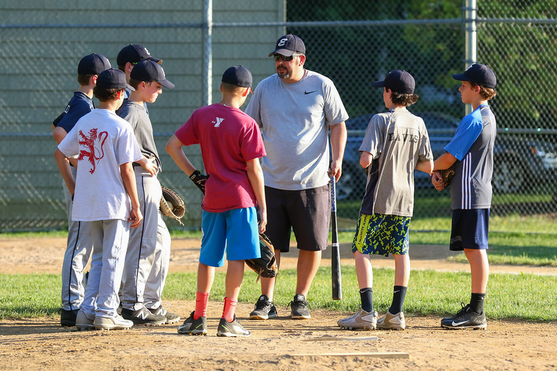 Exeter Baseball All-Star U12 70' coach Matt Perodeau talks with his players during a break at Monday's practice at Currier Field on 6-12-2017, Exeter, NH.  Matt Parker Photos