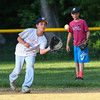 Exeter Baseball All-Star U12 70' player Dylan Shapiro steps in to make a catch with out fielder Nolan Bleakley looking on at Monday's practice at Currier Field on 6-12-2017, Exeter, NH.  Matt Parker Photos