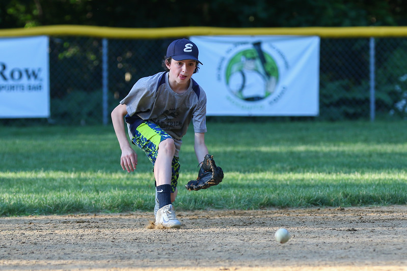Exeter Baseball All-Star U12 70' player Roger Davis looks to pick up a grounder on a hot Monday evening during practice at Currier Field on 6-12-2017, Exeter, NH.  Matt Parker Photos