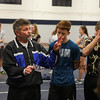 """Winnacunnet coach Richard Osborne, """"Ozzie"""" gives instructions to the long distance runners at Monday's Winter Indoor Track practice on 12-10-2018 at UNH.  [Matt Parker/Seacoastonline]"""