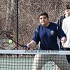 Winnacunnet's Dimitri Minichello makes a play at the net at Wednesday's Boys Tennis practice on 3-28-2018 @ WHS.  Matt  Parker Photos
