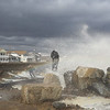 Photographer standing on a rock with sea spray in the air at North Beach on and overcast and windy Saturday 3-3-2018, Hampton, NH.  Matt Parker Photos