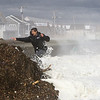 Quinn running from a wave at North Beach on and overcast and windy Saturday 3-3-2018, Hampton, NH.  Matt Parker Photos