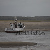 """Sea Fever"" Fishing Boat sitting on sand at low tide in the  Black Water River.  Photo taken from Harborside Dunes Seabrook NH, on an overcast rainy Monday evening on 9-10-2018.  Matt Parker Photos"