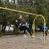 Girl on swing at the Rotary International playground on Academy Ave on Friday 4-5-2019 @ Hampton, NH.  Matt Parker Photos