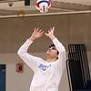 Winnacunnet's Ben Allen sets the ball at Monday's Boys Volleyball preseason practice on 4-8-2019 @ WHS.  [Matt Parker/Seacoastonline]