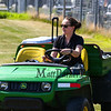 "Athletic Trainer Chantal Filiau on her John Deer ""Gator"" at the WHS Football Veer Camp and team cookout on Sunday 8-11-2019 @ Winnacunnet High School.  Matt Parker Photos"