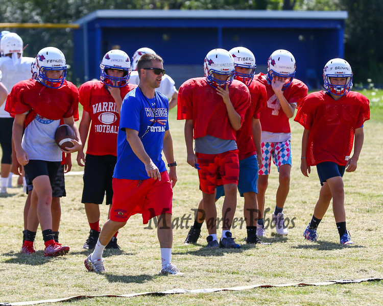 WHS Coach Larry Francoeur gives instructions at Sunday's WHS Football Veer Camp and team cookout on 8-11-2019 @ WHS.  [Matt Parker/Seacoastonline]