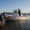 Returning from fishing, Michael Sander and Karl Jacobson load their 90 HP center consol boat at the Glade Path boat ramp, Seabrook Hampton Estuary photos on Thursday 9-19-2019, Hampton Beach and Seabrook NH.  2019 SHEA Photo Contest Runner-up, Recreation.  Matt Parker Photos