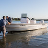 Michael Sander and Karl Jacobson loading their 90 HP center consol boat at the Glade Path boat ramp, Seabrook Hampton Estuary photos on Thursday 9-19-2019, Hampton Beach and Seabrook NH.  Matt Parker Photos