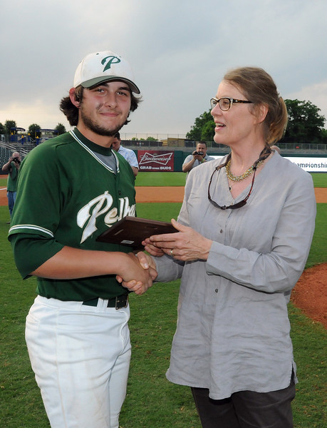 Thomas Lowery of Pelham accepts the MVP award for his play in the 6A AHSAA state championship finale won by Pelham 1-0 over Hewitt-Trussville at Riverwalk Stadium in Montgomery, Ala., May 18, 2013.  By David Bundy