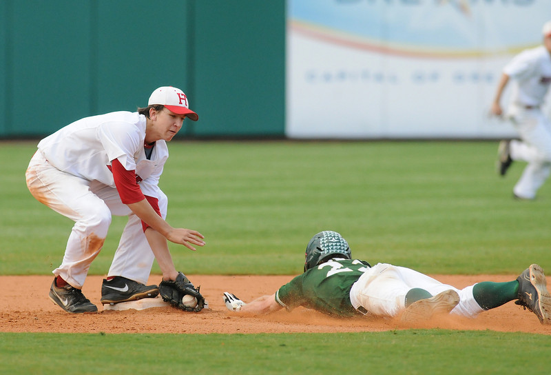 Pelham's Fletcher Johnson, right, is out at second by Hewitt-Trussville's Carter Pharis in the 6A AHSAA state championship finale won by Pelham 1-0 over Hewitt-Trussville at Riverwalk Stadium in Montgomery, Ala., May 18, 2013.  By David Bundy