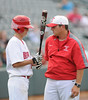 Hewitt-Trussville head coach Jeff Mauldin talks to batter Jasen White in the 6A AHSAA state championship finale won by Pelham 1-0 over Hewitt-Trussville at Riverwalk Stadium in Montgomery, Ala., May 18, 2013.  By David Bundy
