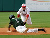 Pelham's Chase Brashier, bottom, is safe at second as Hewitt-Trussville's Carter Pharis closes at second in the 6A AHSAA state championship finale won by Pelham 1-0 over Hewitt-Trussville at Riverwalk Stadium in Montgomery, Ala., May 18, 2013.  By David Bundy